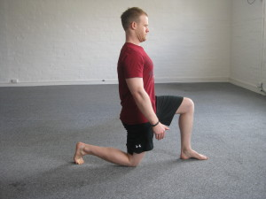 The half kneeling position is the foundation for all the split stance exercises to follow.